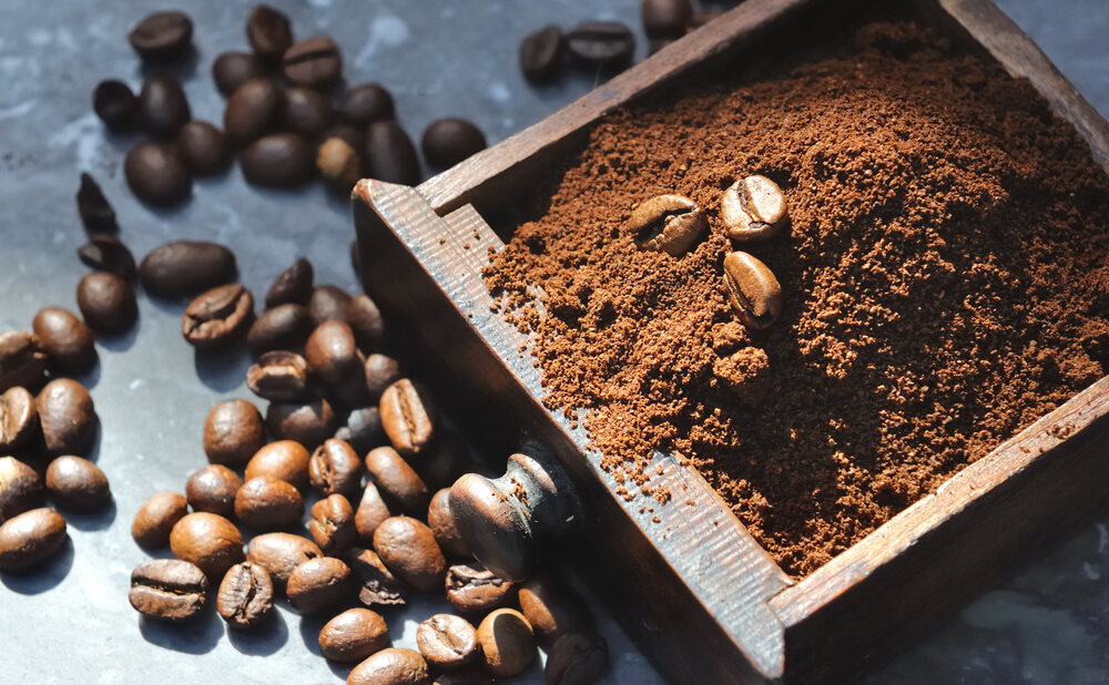 what are coffee grounds - coffee beans and ground coffee in wooden box