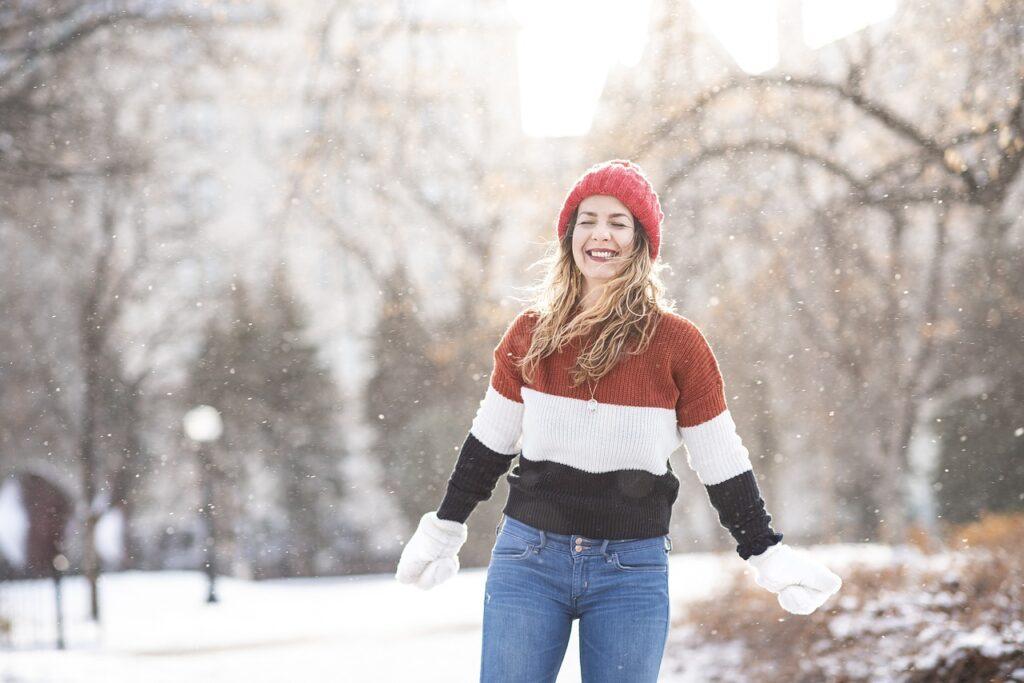 happy woman enjoying snow