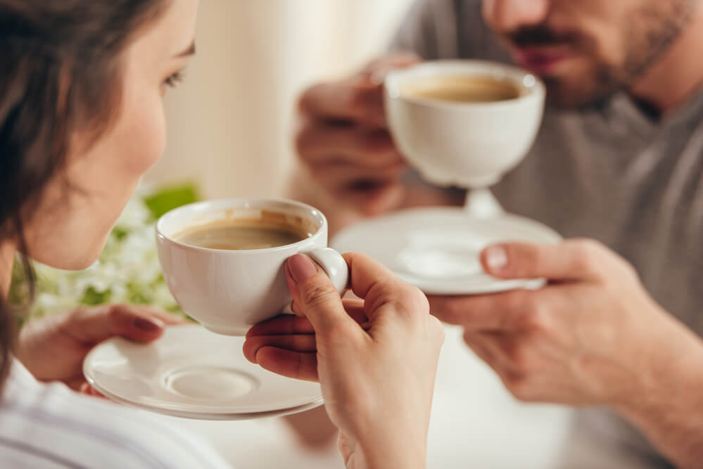 a couple enjoying their cup of coffee