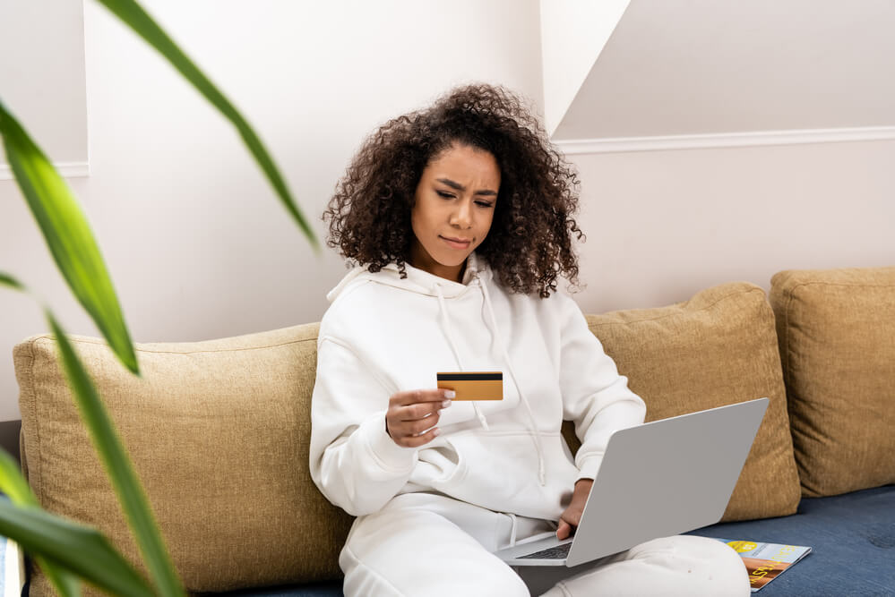 woman comtemplating wether to apply for a coffee subcription online