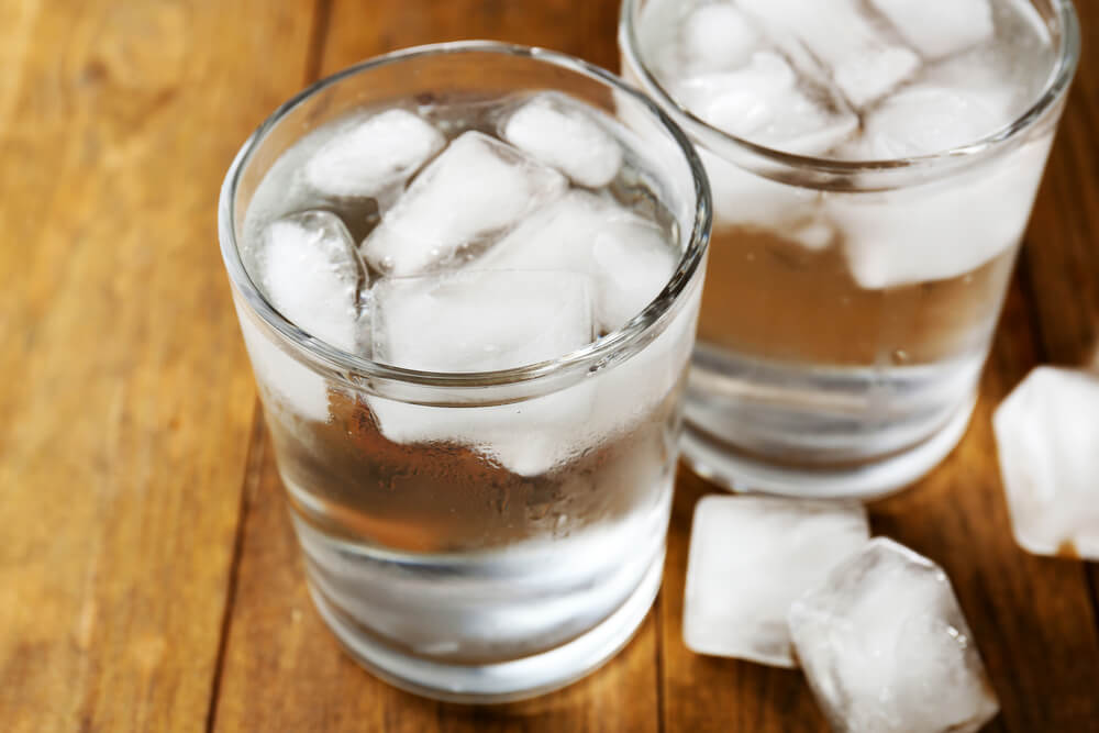 a clear glass of water filled with ice cubes