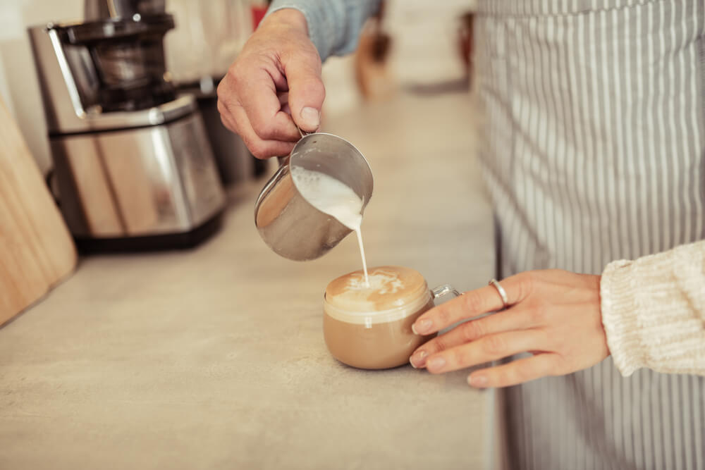 milk frother poured in dalgona coffee
