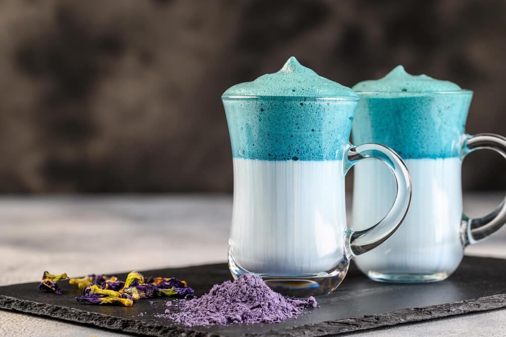 two cups of matcha dalgona blue latte