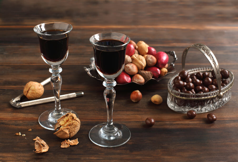 Two glasses of Coffee Liqueur, chocolate and nuts - What To Mix With Coffee Liqueur