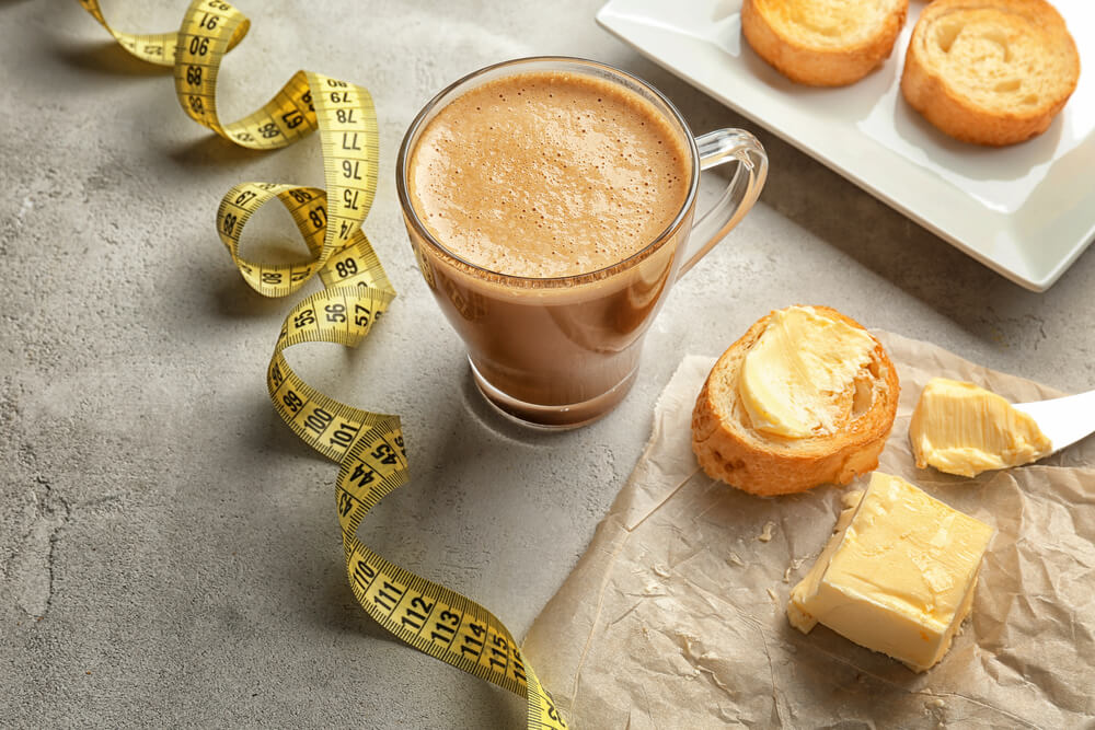 a cup of bulletproof coffee, a bread, a cheese