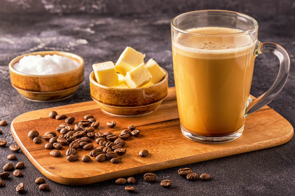 A glass of Bulletproof coffee, blended with organic butter