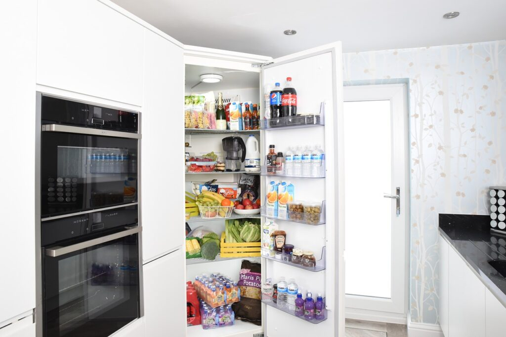 an open fridge full of grocery items