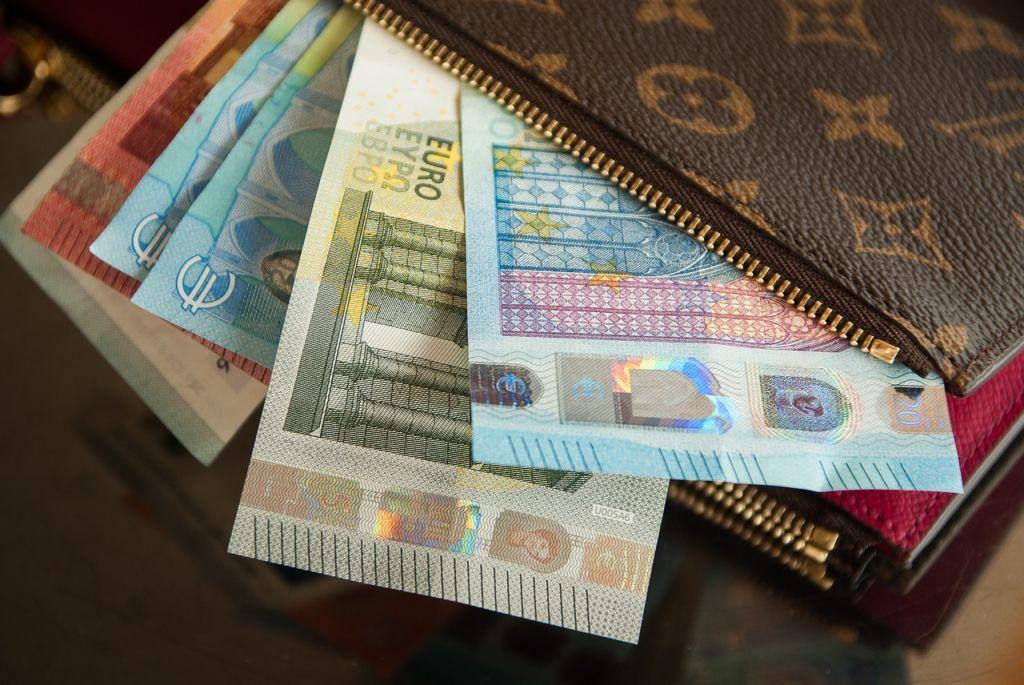 wallet full of european money bills
