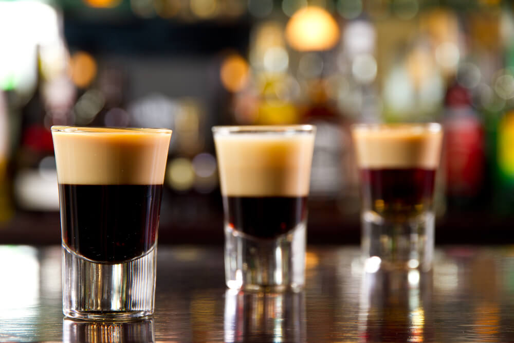 shots of coffee drink with rum in a table