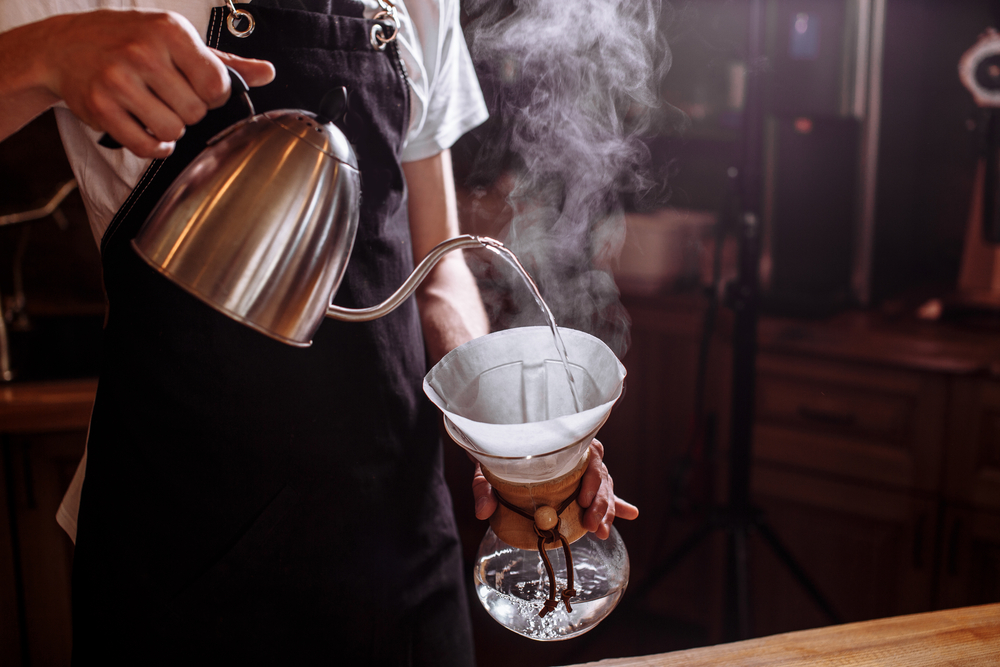 pouring a hot water over a pour over coffee