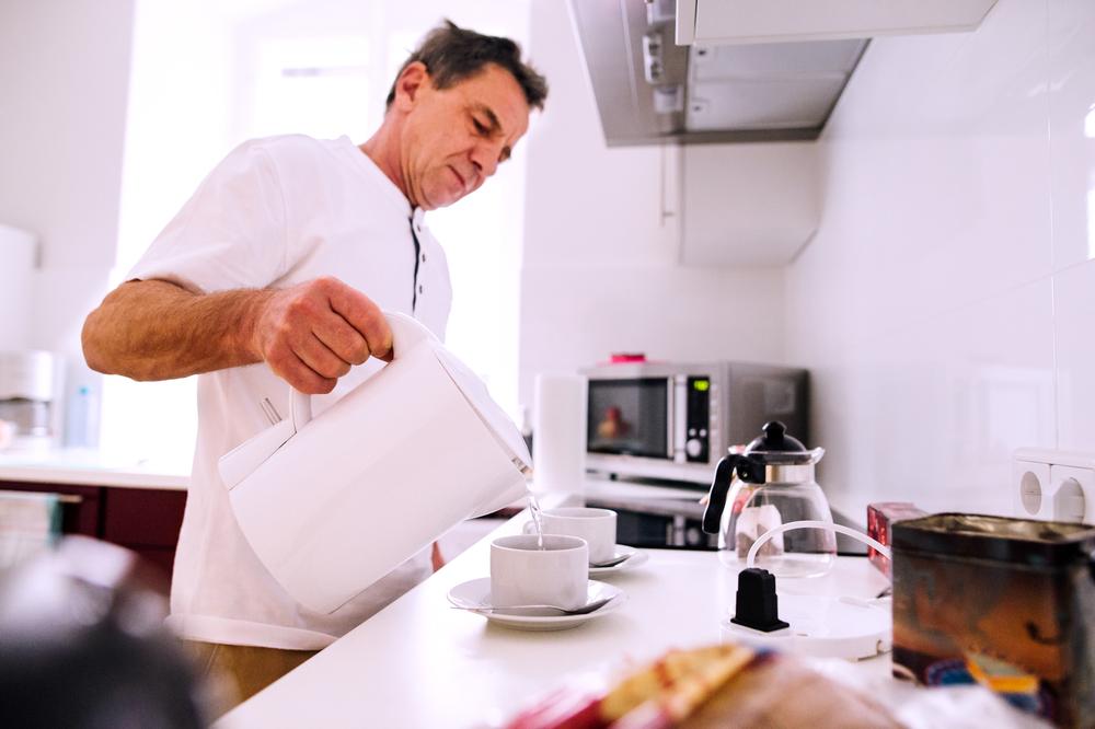 senior man preparing a hot tea