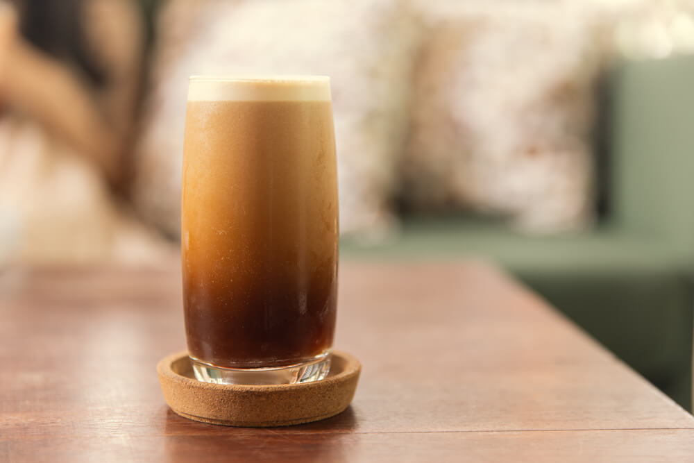 Nitro Coffee drink in the glass with bubble foam