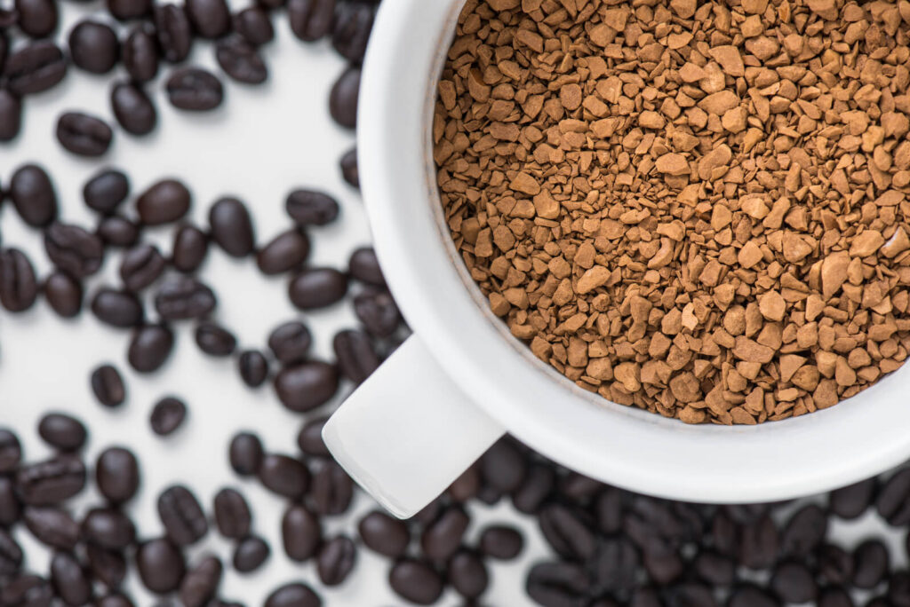instant coffee in cup with coffe bean