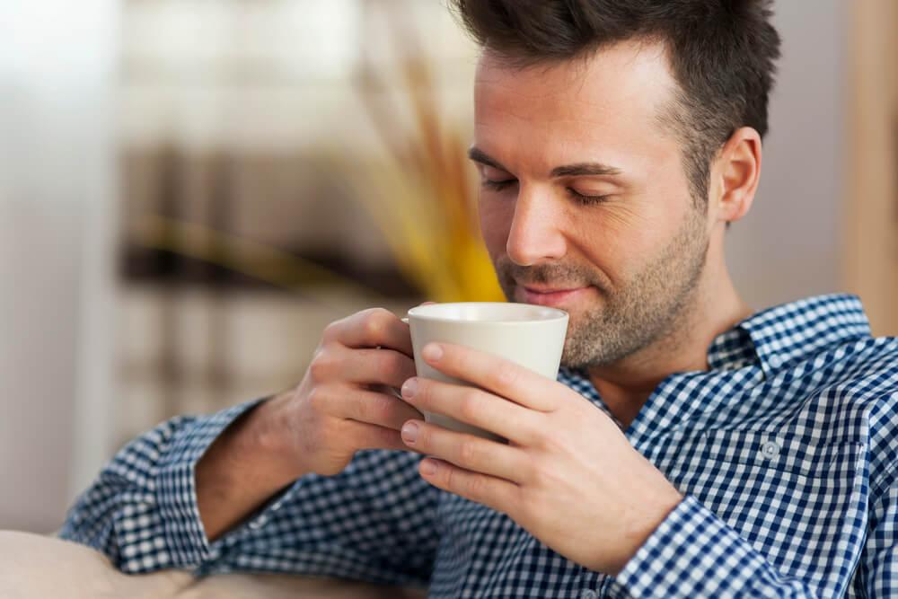 man tasting coffee
