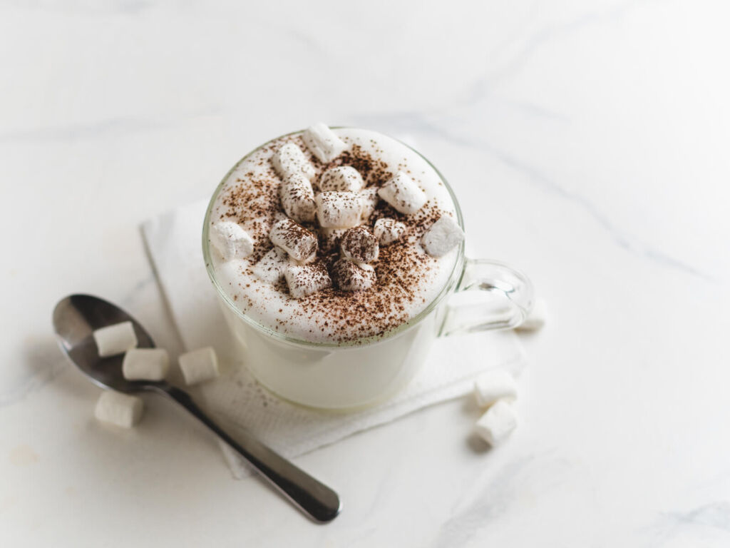 Babyccino - whipped milk or cream with cocoa or cinnamon powder and marshmallow