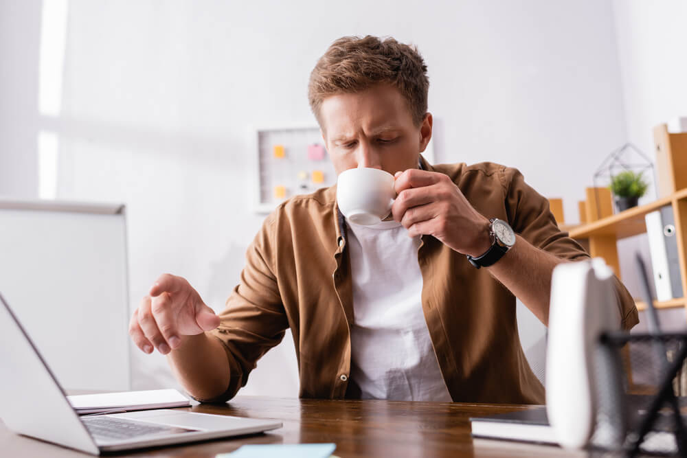 a businessman drinking coffee on his office