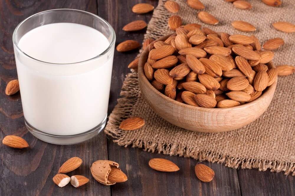 a cup of almond milk with almonds