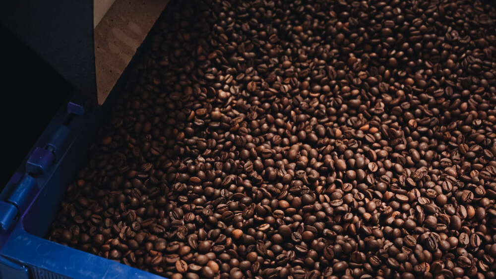 thousands of coffee beans on a compartment