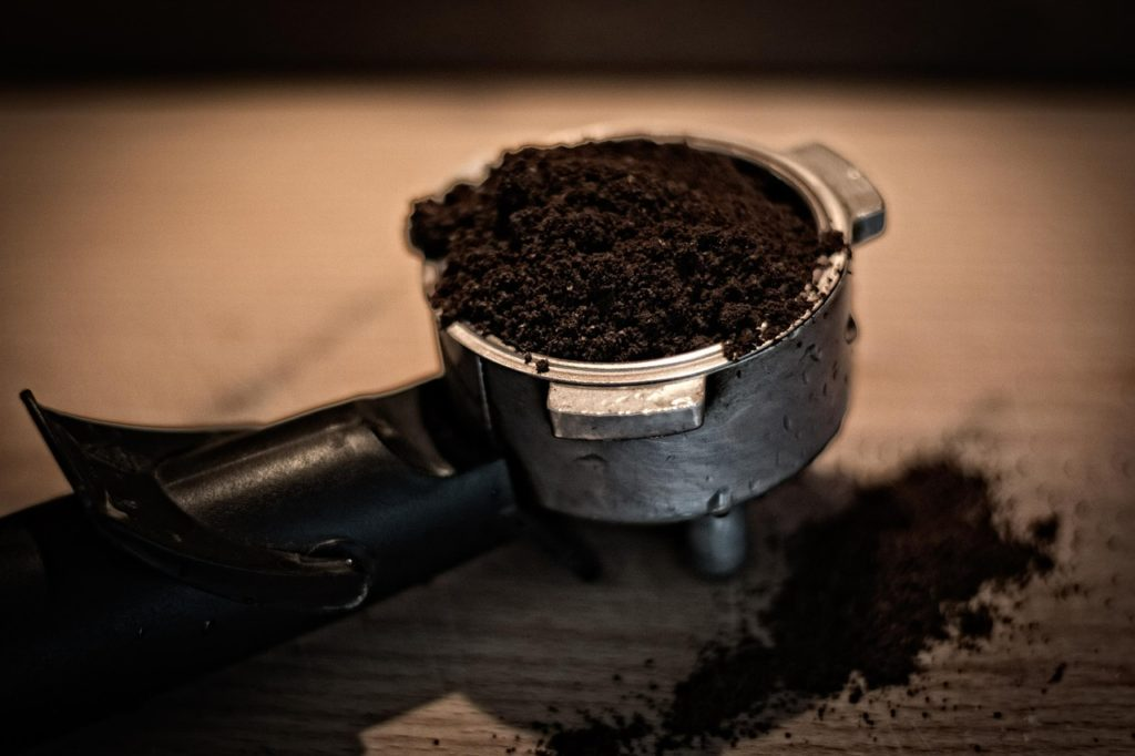a scoop of coffee grinds