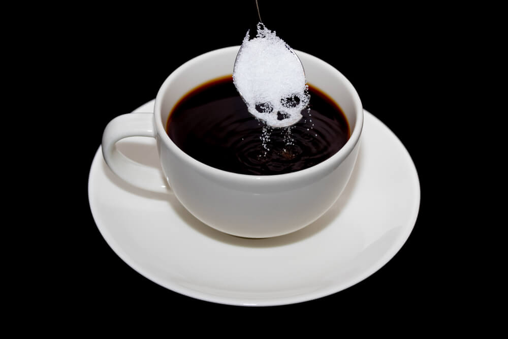 a cup of coffee with a mark of a skull