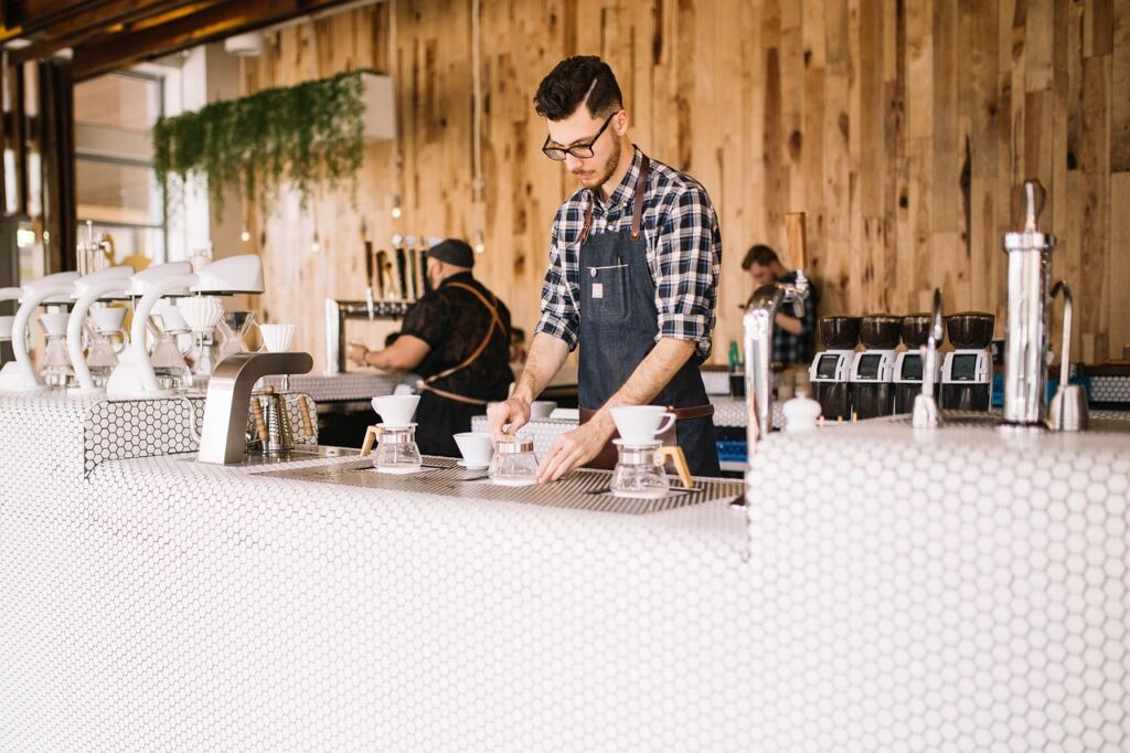 Man arranging the coffee shop equipment