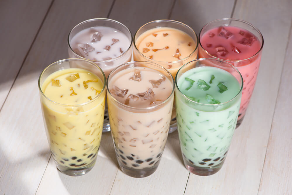 various bubble tea in a wooden table