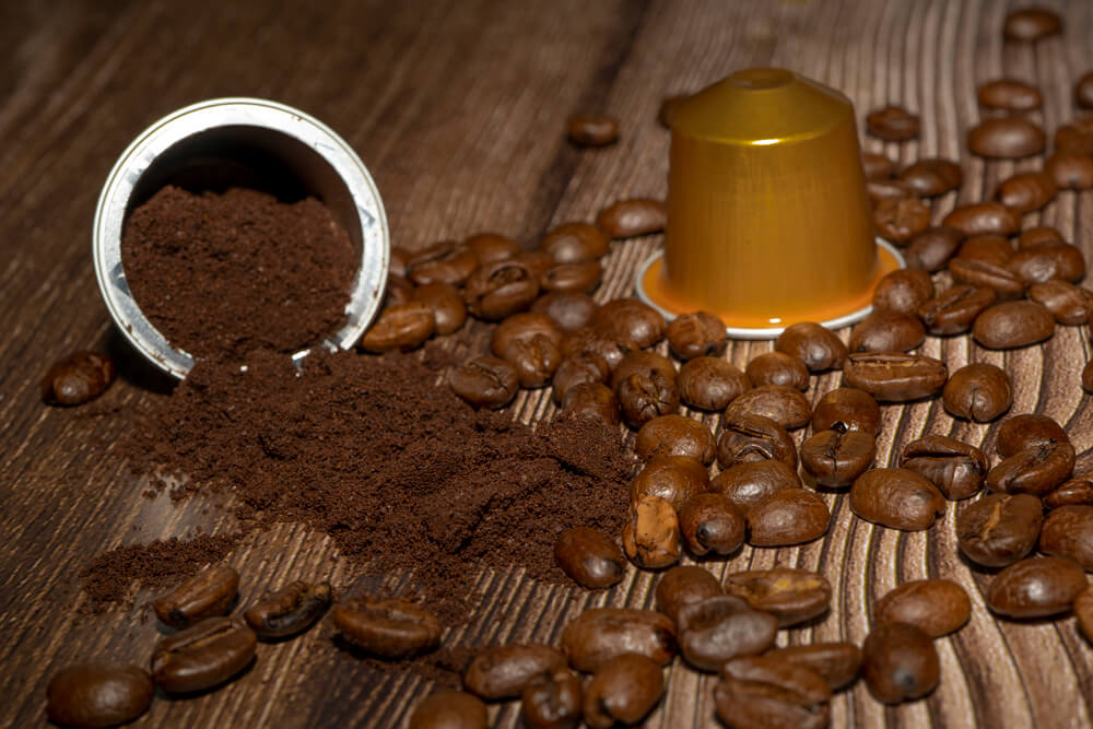 Open Espresso coffee capsule with grounded coffee