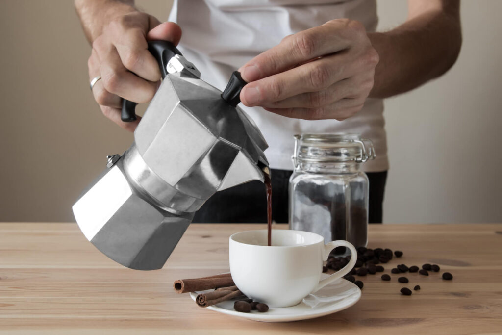 Pouring coffee out of Italian coffee pot