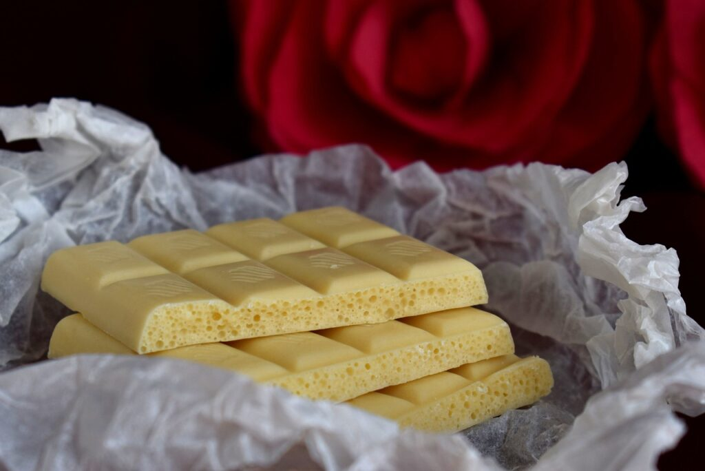 three bars of white chocolate in a plastic wrap