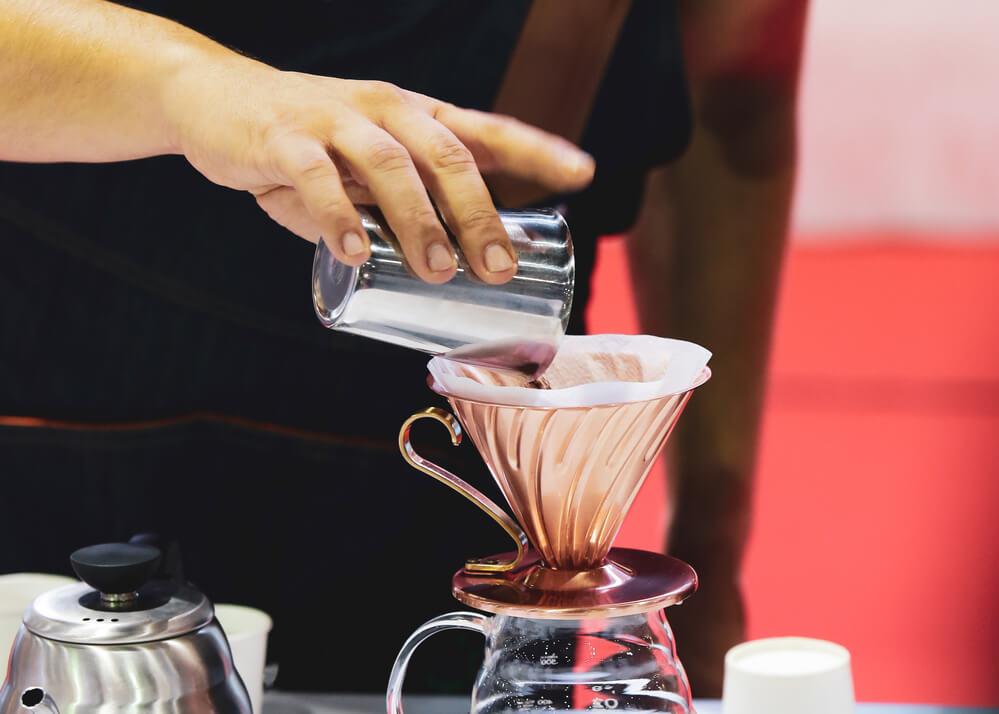 Barista is making coffee using Melitta