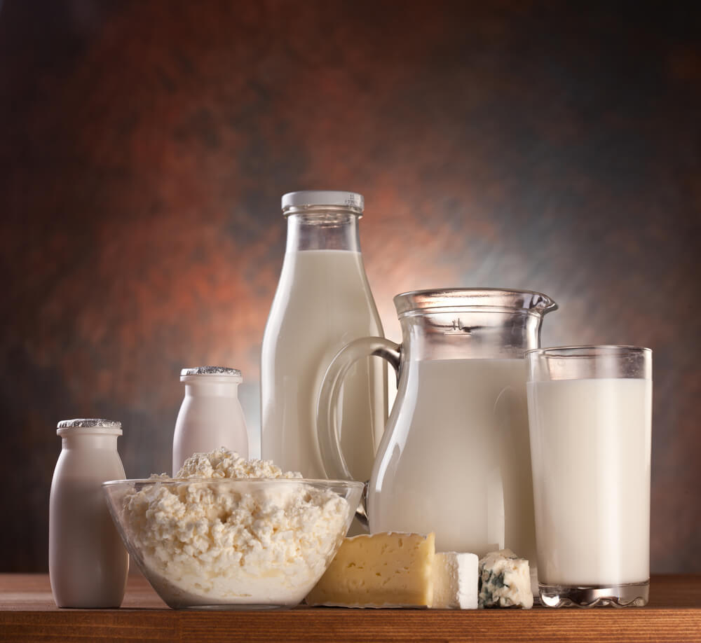 Which milk is best for frothing. Milk contained in different types of container with raw ingredients in front them