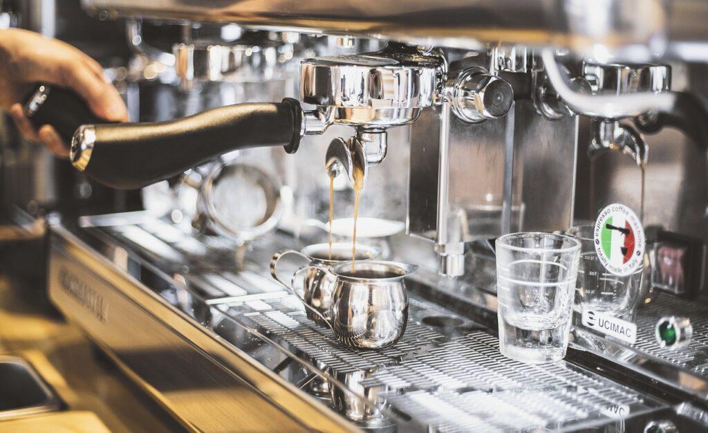 Chemex vs auto drip - Coffee americano machines expelling a fresh brewed coffee to a cup,