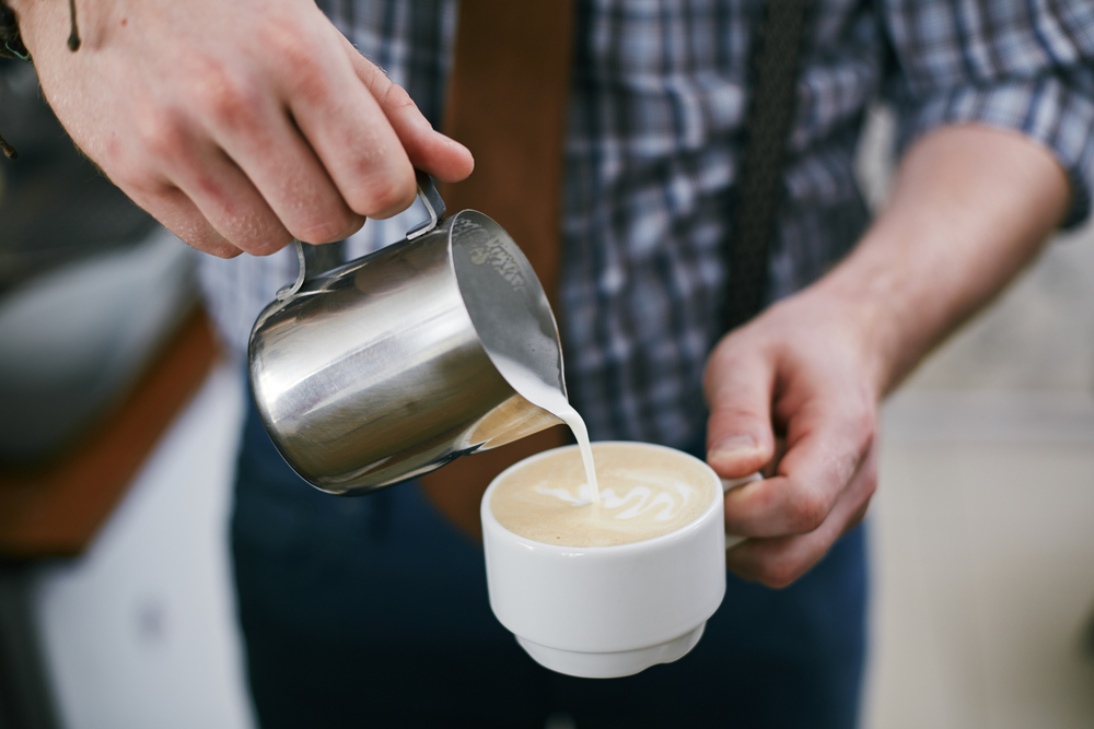 Milk frothed poured in a cup of coffee