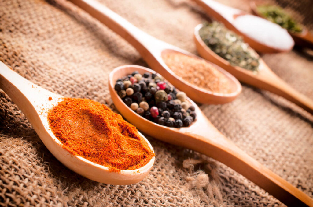 Spices in a wooden spoon.